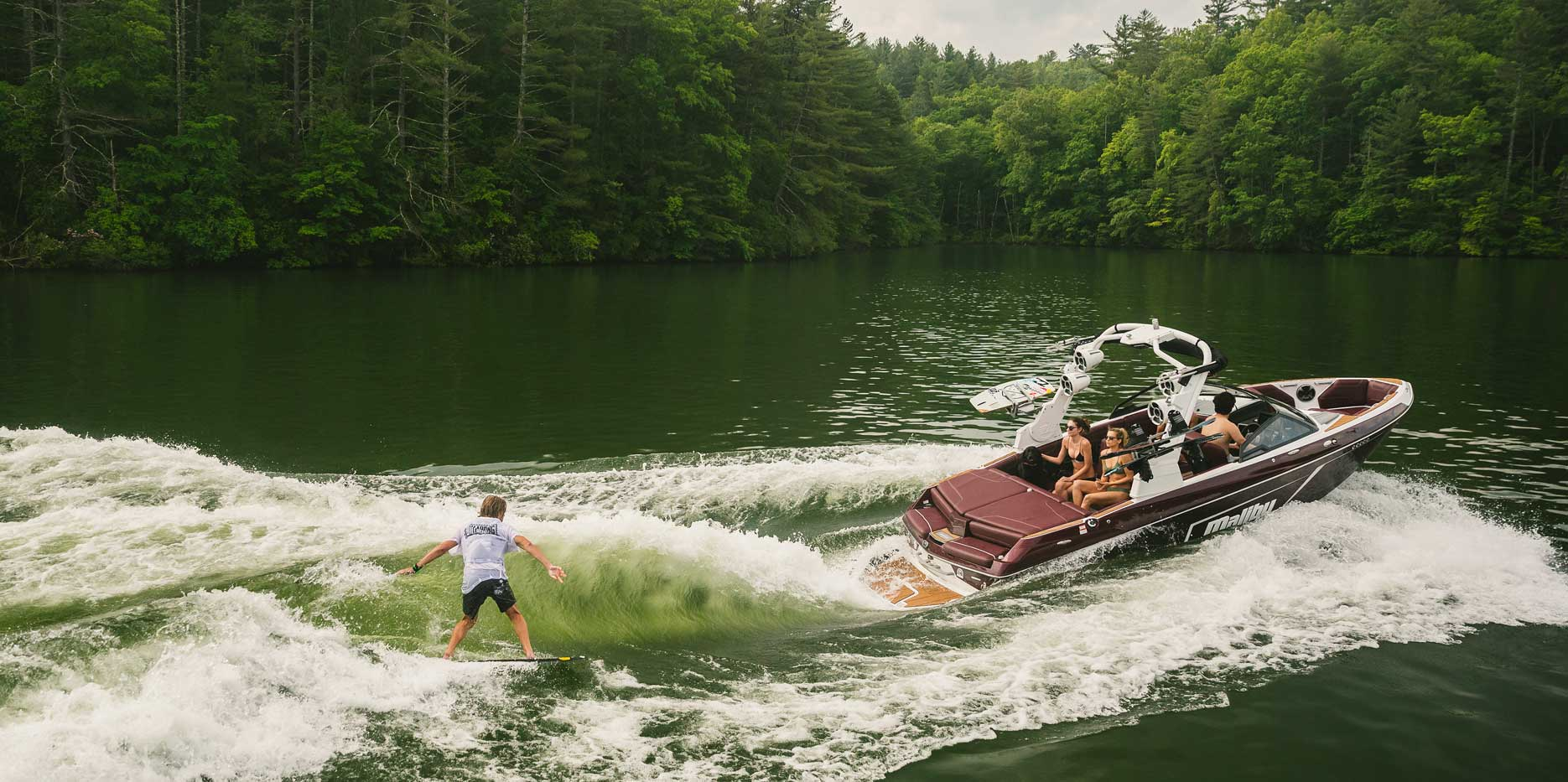 Wakesurfing behind the 22 LSV is a breeze with the Integrated Surf Platform.