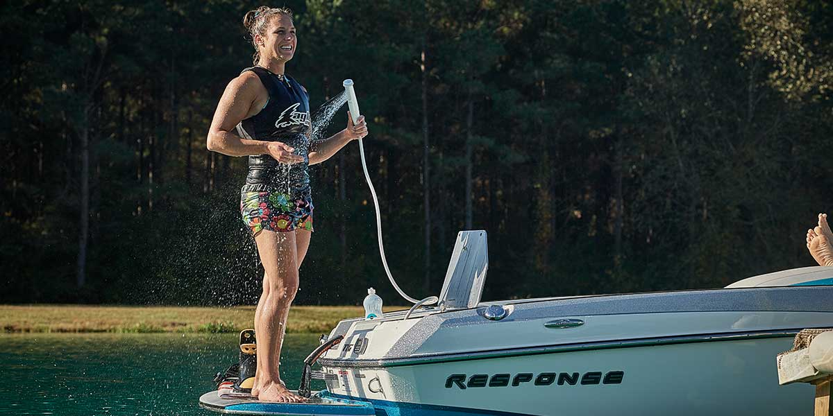 Malibu Boats Regina Jaquess using the Response TXi built in shower. It makes it so simple to slide into boots!